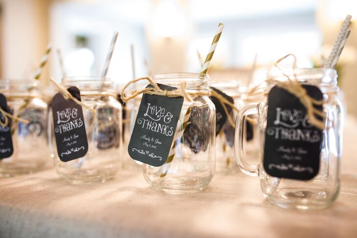 Keeping with the DIY and rustic elements of the day, Mandy and Jesse gave their guests glass mason jars with gold and silver straws and black thank-you tags as wedding favors.