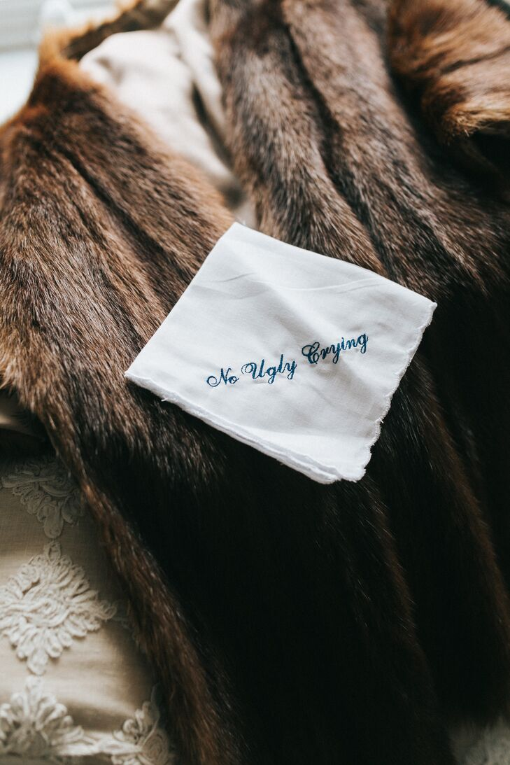 Just in case she needed reminding, Lexie carried this playfully embroidered handkerchief during the ceremony.
