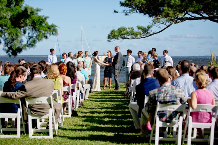 The first time Shelly stayed at the Stallings, she fell in love with it's rustic, sea inspired decor. They decided to get married on the lawn, with the boats Ben grew up sailing anchored behind them, and paintings by Shelly's mom on easels framing them.