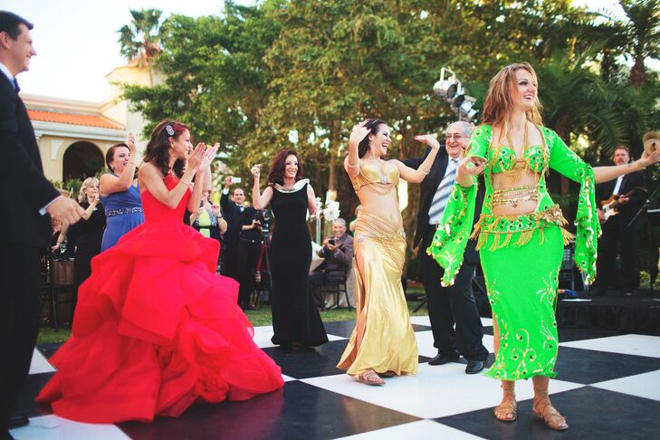 """""""The element of having our cultures incorporated with the mini """"Zaffa"""" belly dancers and Arabic drummers for the reception entrance added a unique touch many had not experienced,"""" say Amina."""