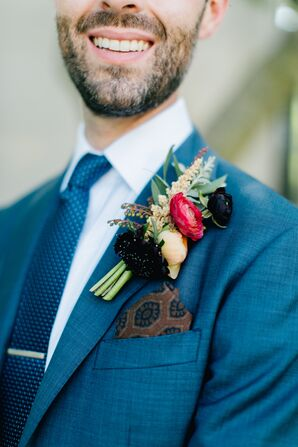 Blue Suit with Patterned Accessories and Bright Boutonniere