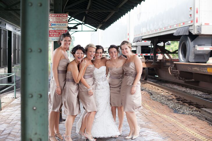 The bridesmaids wore knee length, strapless satin dresses in champagne.