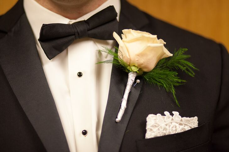 Jonathan wore an ivory rose boutonniere as well as a lace pocket square to distinguish himself from the groomsmen.