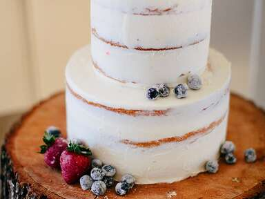 Winter wedding cake idea with frosted berry garnish