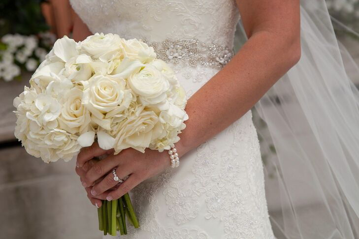"""""""The moment I tried on my wedding dress, I knew that was the one,"""" Stephanie says. Since she wanted all eyes on its ornate beadwork, she steered clear of colorful blooms. Her all-white bouquet was made up of calla lilies, roses and hydrangeas."""