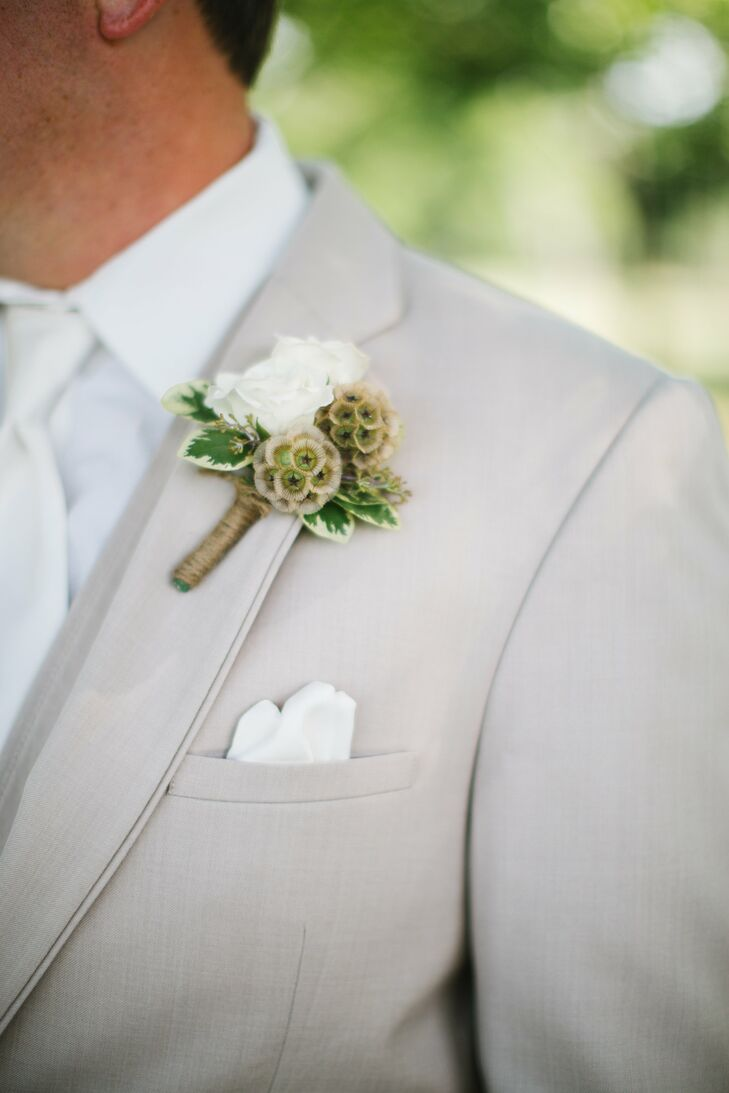 The two small roses on Owen's lapel were paired with tiny scabiosa pods.