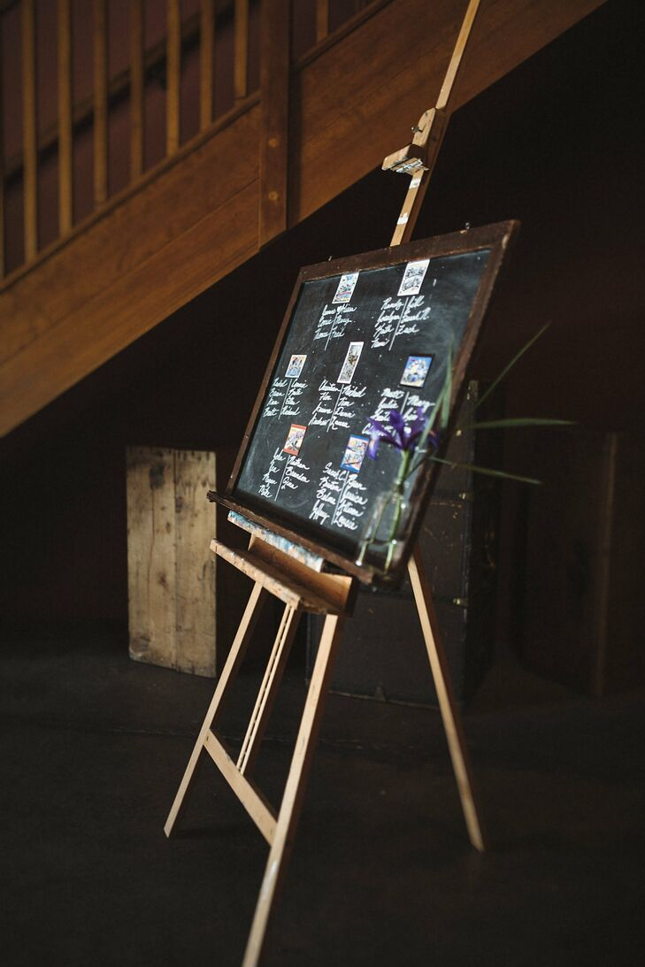 The couple used a chalkboard to inform guests of their seating assignments.