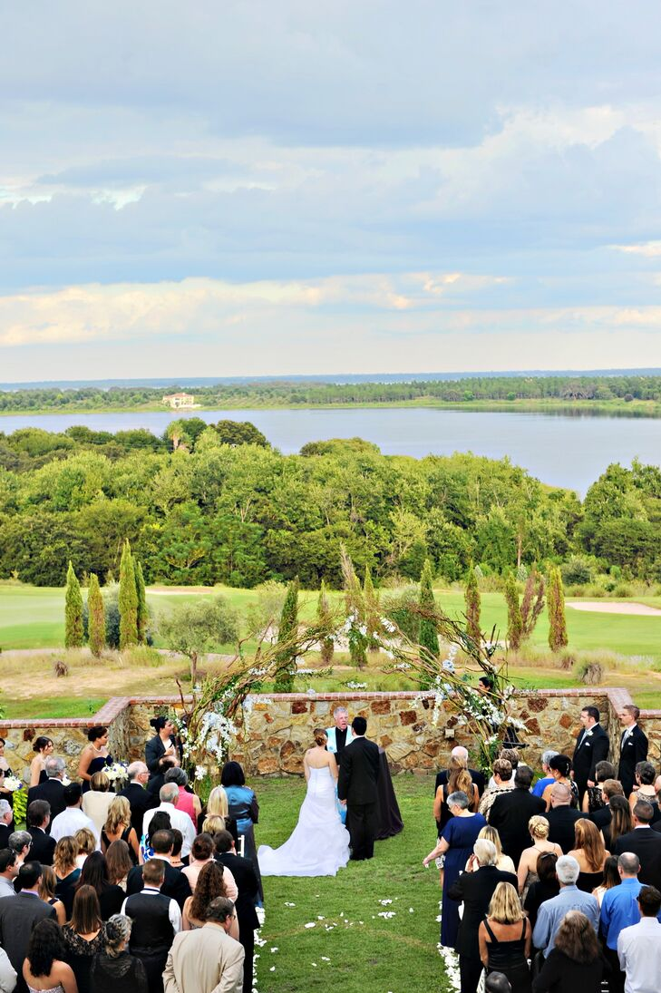 """The venue sits on a hill overlooking a lake and a vineyard inspired landscape that looked more like an estate in Italy than Central Florida,"" the couple says."