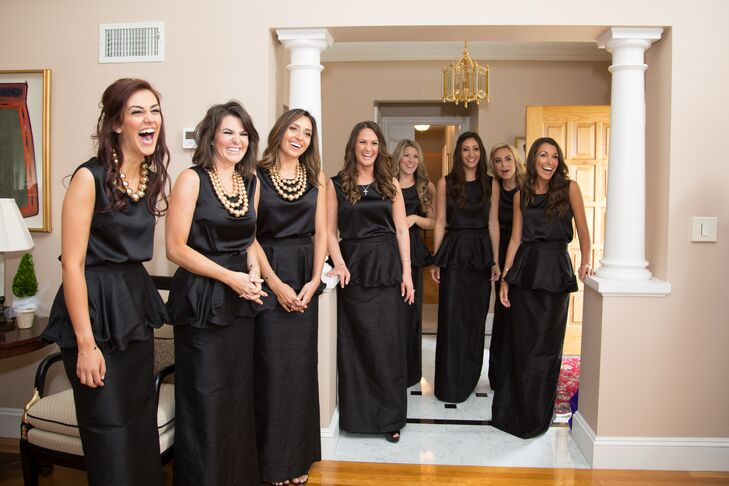 The bridesmaids wore custom black, floor-length peplum skirts with black silk blouses Allison Collection in New York City.