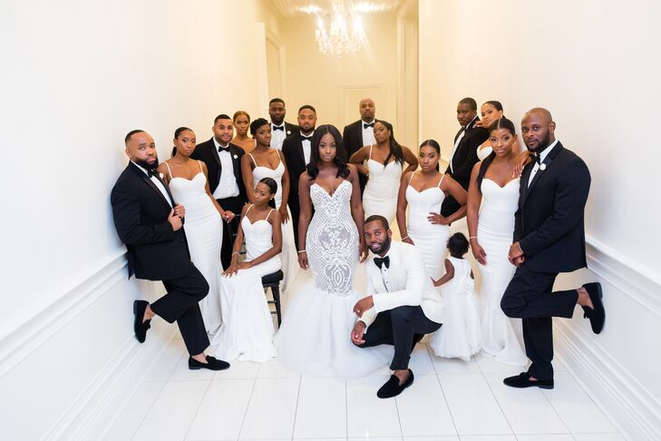 White Bridesmaid Dresses and Groomsmen in Black Tuxedos