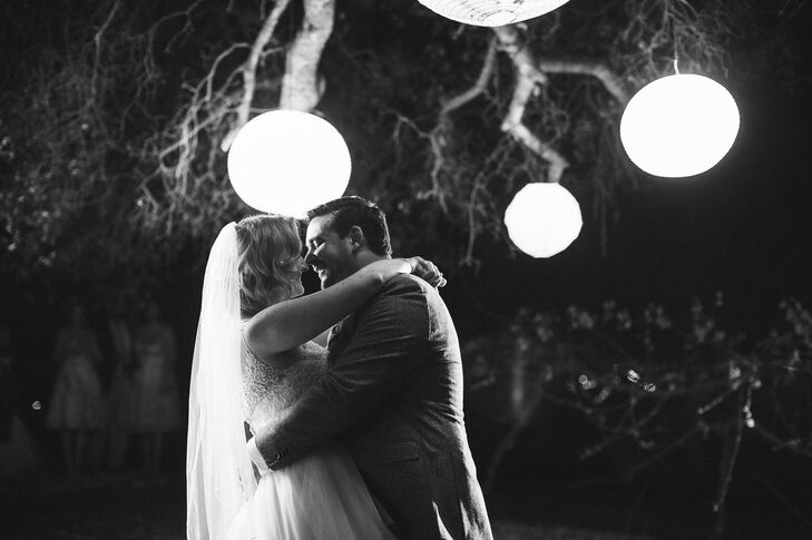 Before heading indoors for the rest of the reception, Blake and Mariellen shared their first dance as husband and wife under an old oak tree illuminated with large paper lanterns.