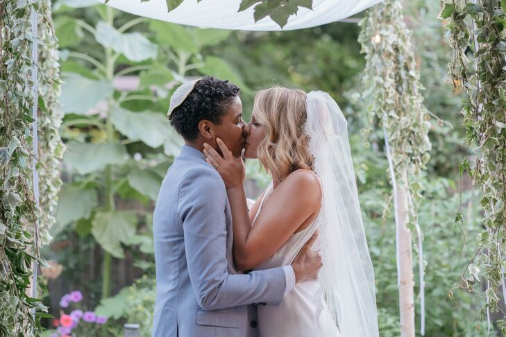 First Kiss Under Chuppah at Outdoor Jewish Ceremony