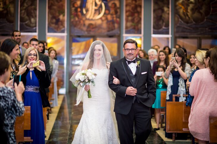 """""""Probably one of my favorite moments was seeing JP's big ol' grin' as I was walking down the aisle,"""" says Bianca. She chose a classic white strapless lace Hayley Paige wedding dress for the ceremony."""