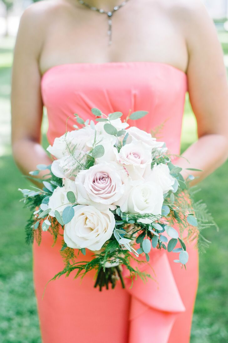Allison's bridesmaids carried small bouquets of ivory and blush roses and eucalyptus leaves. The loose, neutral bouquets matched each of their dresses and echoed Allison's bouquet.