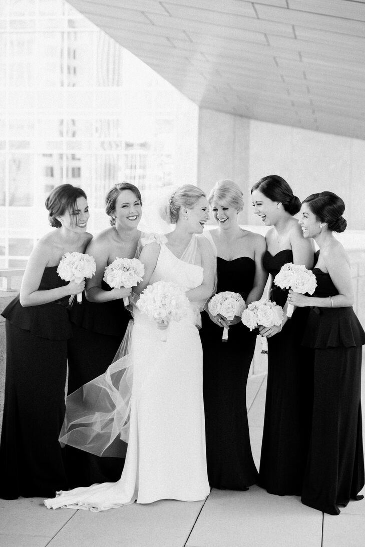 Lynn's five bridesmaids all wore the same black floor-length Badgley Mishka gowns from Rent the Runway. Lynn didn't want her friends to break the bank purchasing dresses and alterations, and loved how affordable and easy Rent the Runway was.