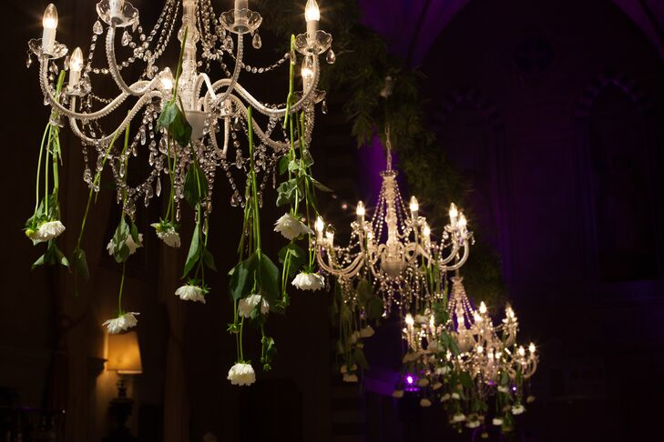 The ornate crystal chandeliers in the Conventino Ballroom at the Four Seasons had white flowers hanging from them to add to the garden theme of Amanda and Solomon's wedding.