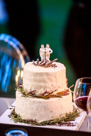 A Small Rustic Buttercream Wedding Cake with Two Groom Cake Topper