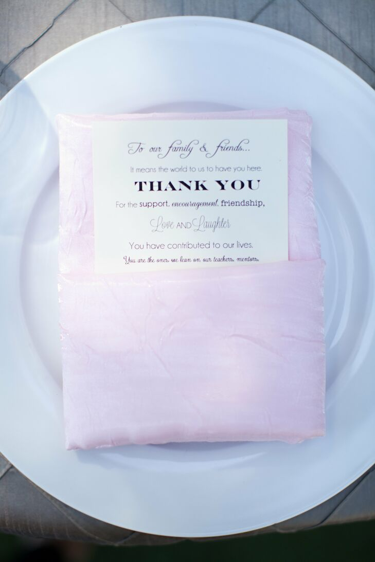 White menu cards were placed in pink napkins, giving the place setting a soft, romantic look.
