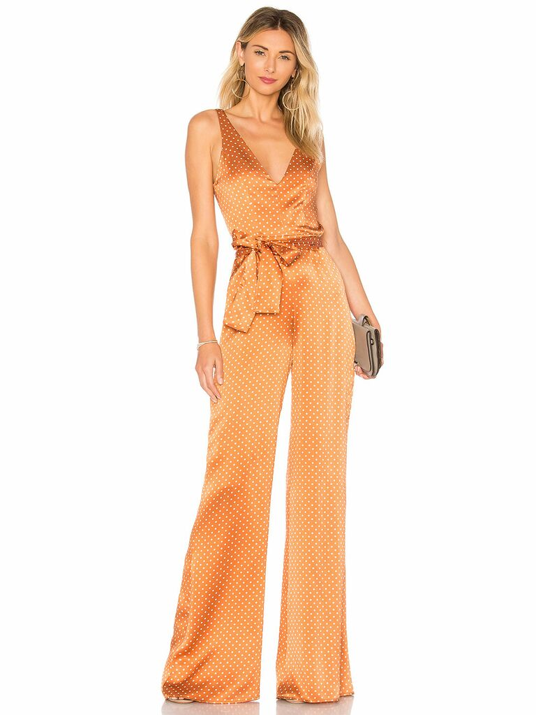 what to wear fall wedding - orange polka dot jumpsuit