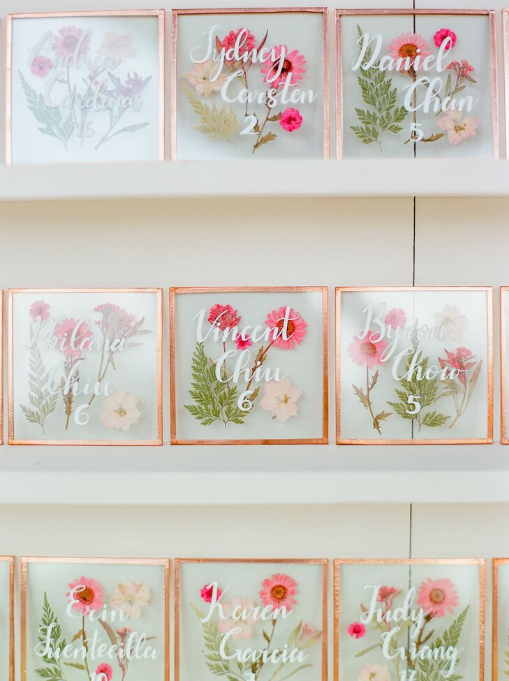 """""""To incorporate our floral theme, we made individually pressed flower coasters with our guests' names and table numbers as escort cards, which doubled as favors,"""" Deborah says."""
