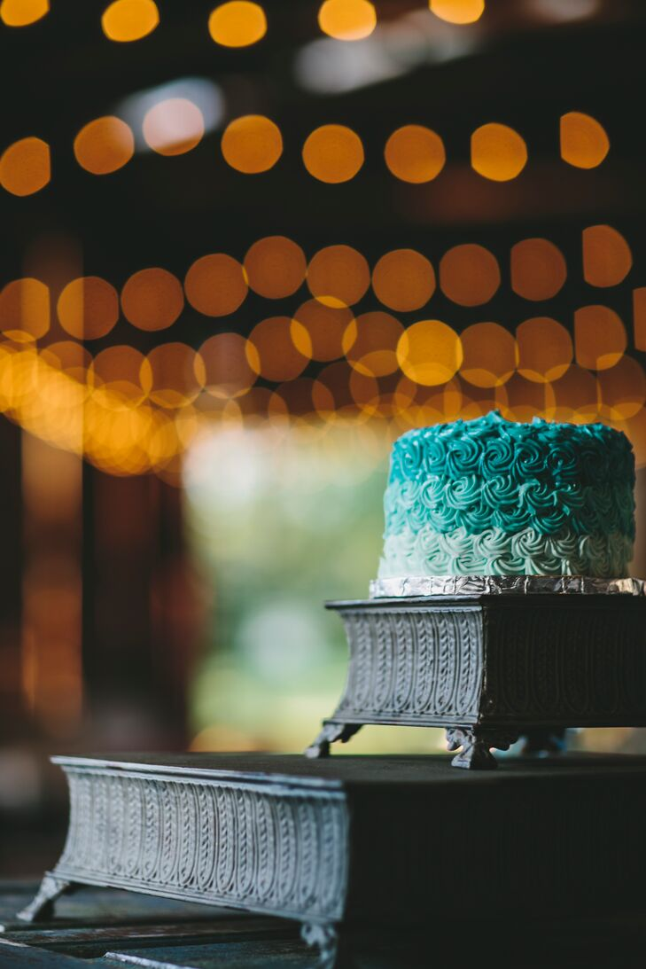 To follow their color scheme, Jess and Dan had a blue ombre round wedding cake filled with red velvet flavoring. The dessert done in rosette designs sat on top of a black woven stand for friends and family to admire.