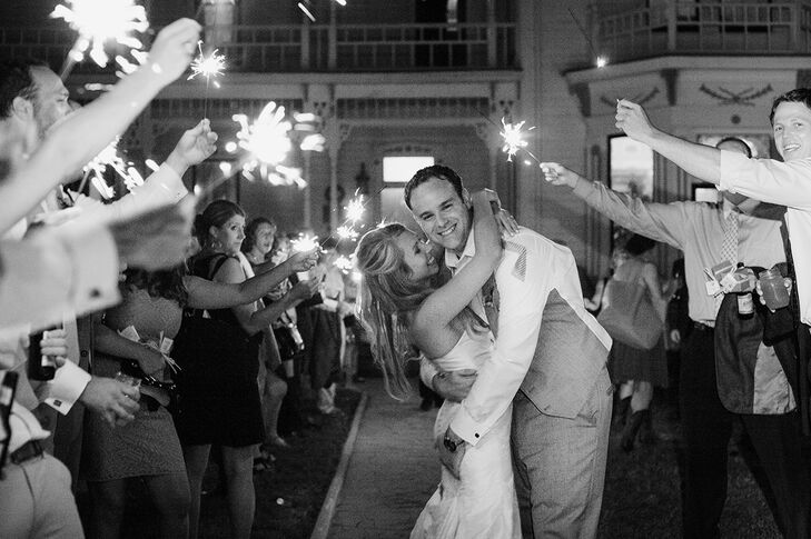 """At the end of the evening, guests were invited to take a sparkler and lined the outside of the mansion for the couple's send-off. """"This was a magical moment for the guests and us as a newly-married couple,"""" says the bride."""