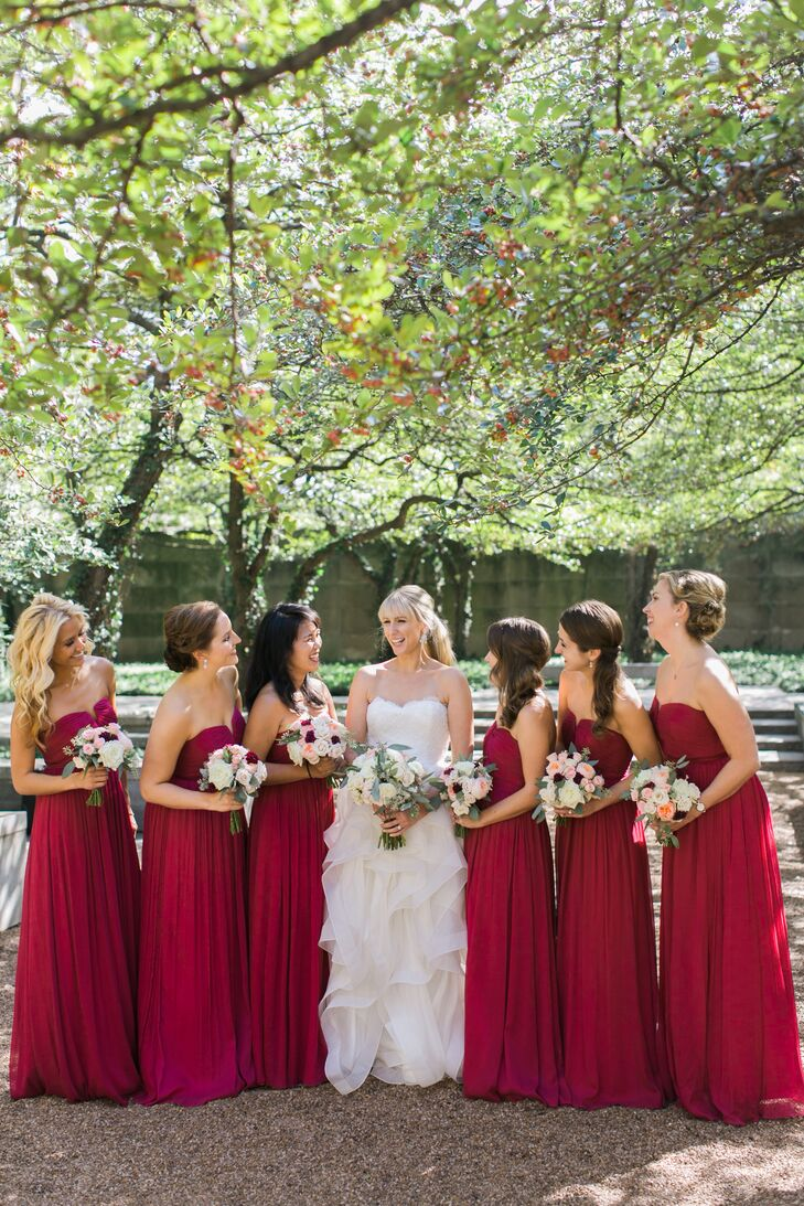 """The bridesmaids wore raspberry red full length gowns from J. Crew. """"We thought they added a pop of color to the venue,"""" Jessica says."""