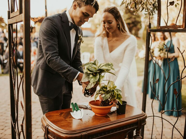 Bride and groom planting succulent during wedding unity ceremony