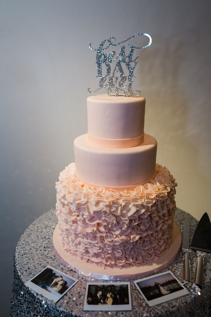Empire Cake crafted this pink tiered salted caramel confection using a design that mimicked Cecilia's custom Leanne Marshall wedding dress.