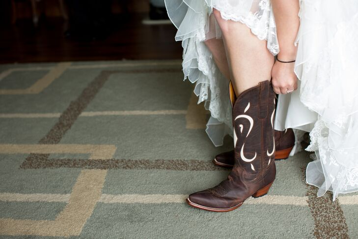 When shopping for her wedding dress, Katie was very specific in finding a gown that could accommodate her bridal shoes—cowboy boots. The bride and her 'maids sported the rugged footwear throughout the day, ensuring comfort and dancing all night long.