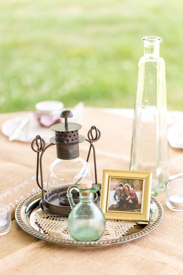 Throughout Leslie and Andrew's seven-month engagement, they collected lots of vintage pieces from antique stores. With the help of their friends and family, the couple arranged their findings into centerpieces. They had everything from galvanized tins and mason jars to lanterns, silver platters and old books decorating each table.