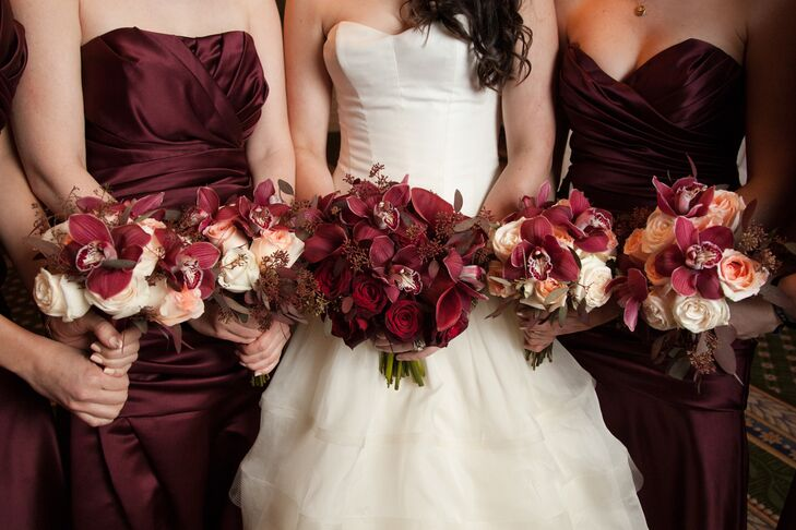 Burgundy Bridesmaid Dresses And Bouquets With Roses Orchids And