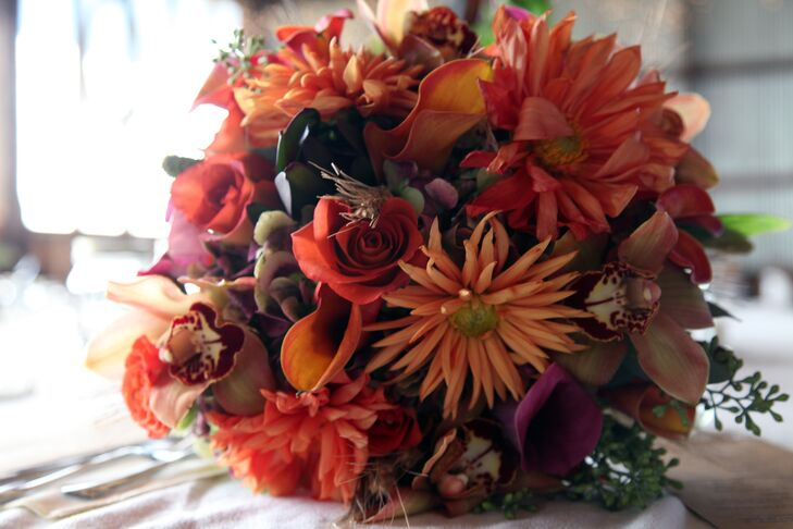 Melissa carried roses, orchids, calla lilies and dahlias in shade of orange, brown and purple.