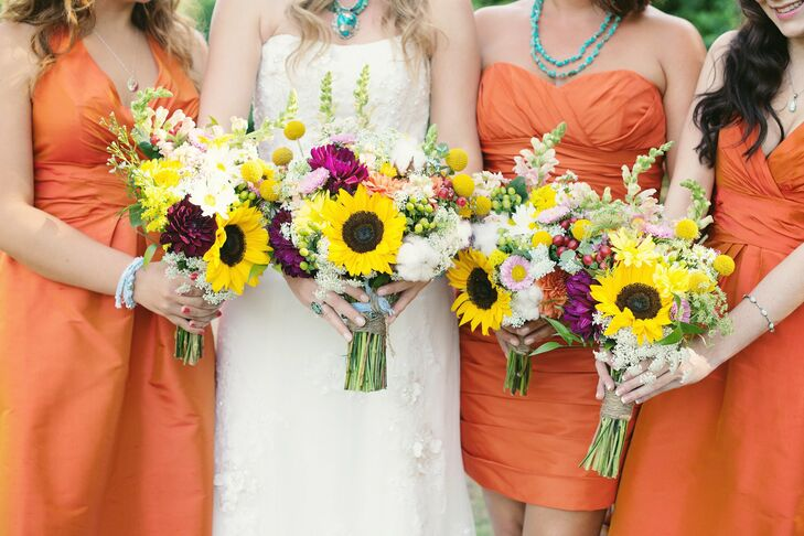 Nicole and her bridesmaids all held matching bouquets filled with vibrant colors. The bouquets were a mix of sunflowers, purple peonies, billy balls, scattered baby's breath, gerberas and cranberries.