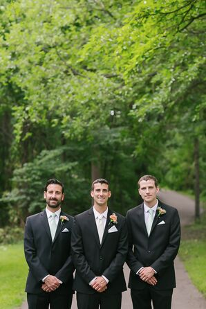 Groom and Groomsmen in Black Kenneth Cole Suits