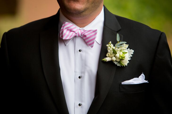 The groom and groomsmen wore pink and white striped linen bow ties from High Cotton Ties.