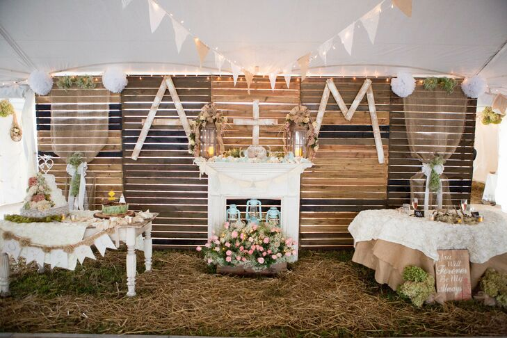 """Marty made a huge pallet wall and pallet bar -- they were both huge hits!"" says Ashley of the reception decor."