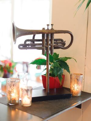 Trumpet Decor Surrounded by Votives