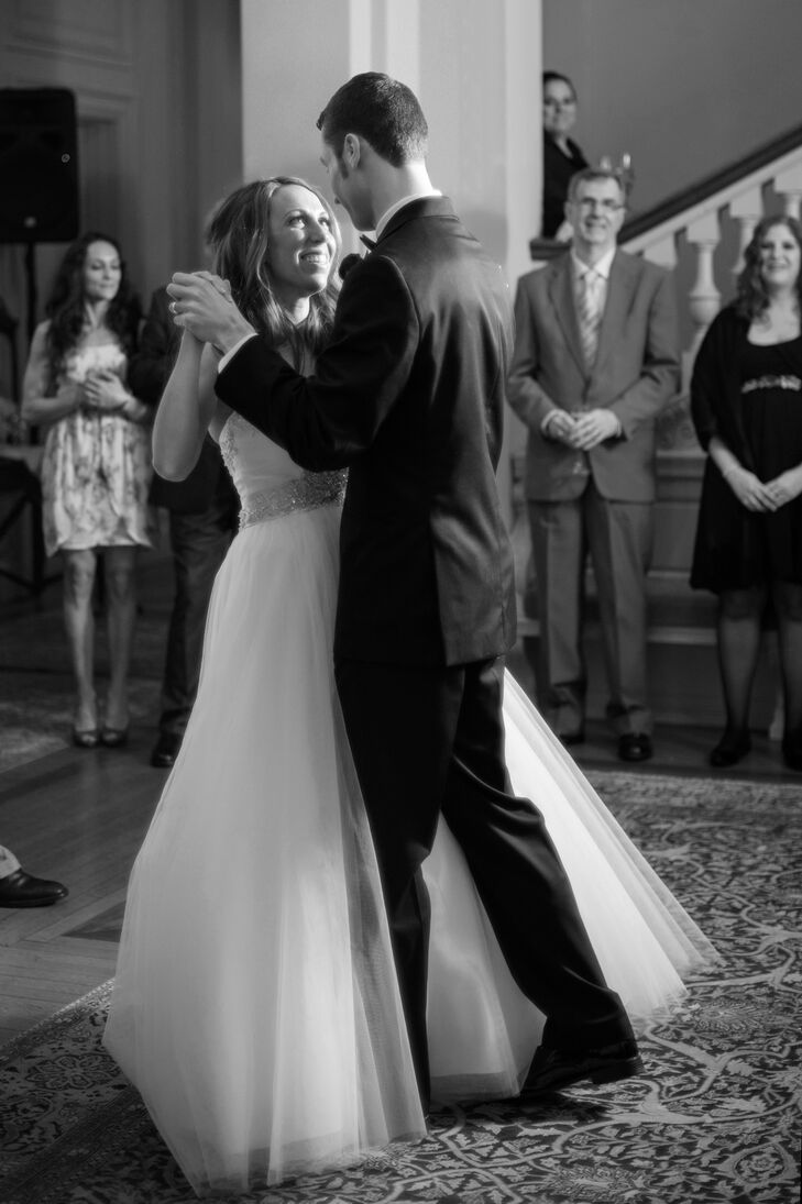 """A self-proclaimed """"control freak couple,"""" Jennifer and John performed a choreographed dance to Elvis's """"I Can't Help Falling in Love"""" for their first dance."""