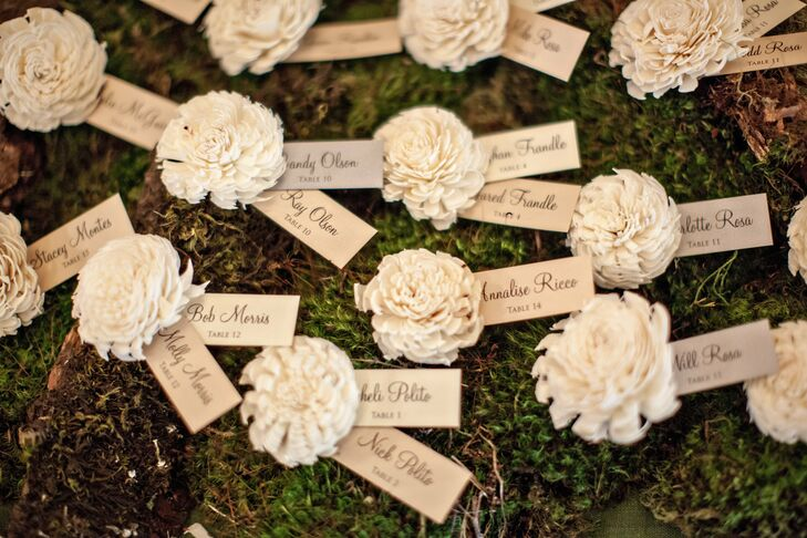 Each escort card was attached to an ivory paper flower for a rustic look.