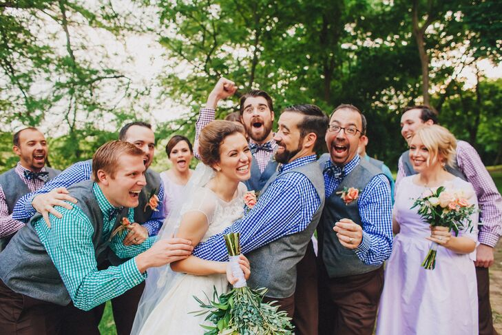 Jason, his two brothers and six close friends wanted to wear something a little more whimsical and colorful for the wedding. So they swapped out formalwear for blue, purple, and turquoise gingham shirts from Lands' End with gray vests from Men's Wearhouse and dark brown Lands' End pants. They even matched the shirts with bold plaid blue ties from the Tie Bar.