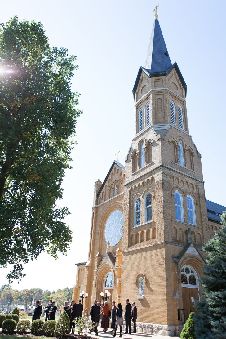 """""""Our ceremony was at my hometown church,"""" Lauren says. """"It's an old German-Catholic church so it was pretty formal."""""""
