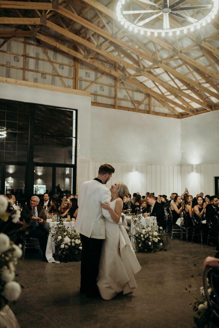 Couple Shares First Dance Inside Barn Wedding Venue