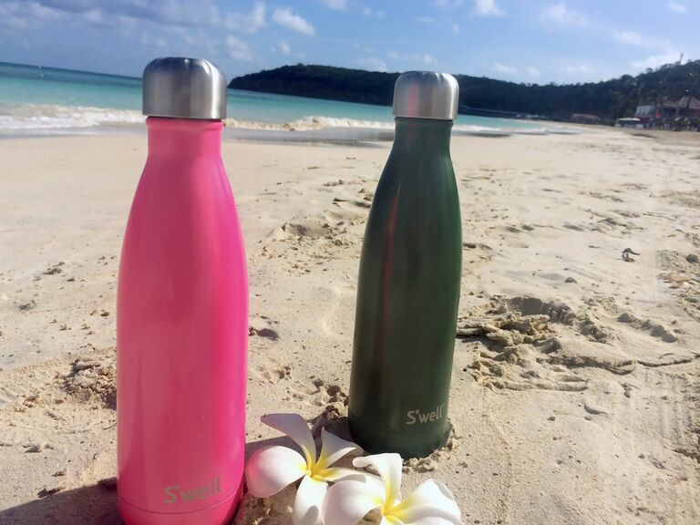 Hot Pink and Green S'well bottles on the beach in Antigua