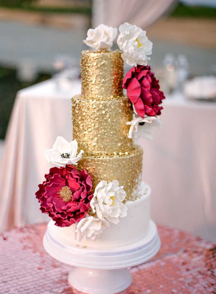 "Marina and Vazgen's four-tier cake was covered with shimmering gold frosting and adorned with crimson and white blossoms. ""The cake was everything I wanted and more,"" Marina says. ""It is something I can look back to and always smile about. It was also very delicious!"""