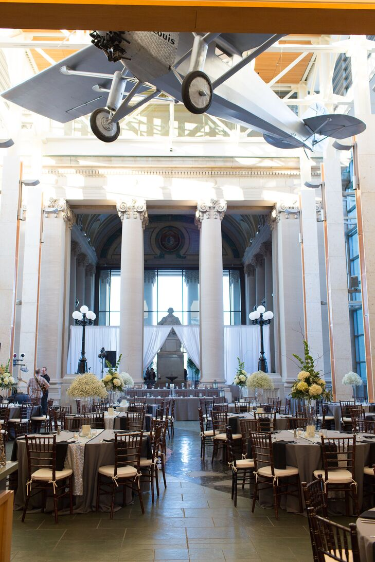 """""""Our reception was at the Missouri History Museum,"""" Lauren says. """"It's a beautifully grand building built in 1913 with soaring ceilings and walls of glass."""""""