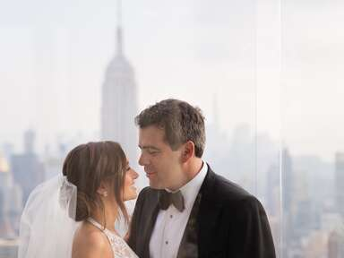 newlyweds with empire state building in background