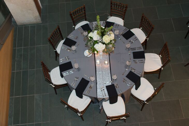Lauren and Kyle decorated their reception tables with gray linens and sparkly silver table runners for a little glamour.