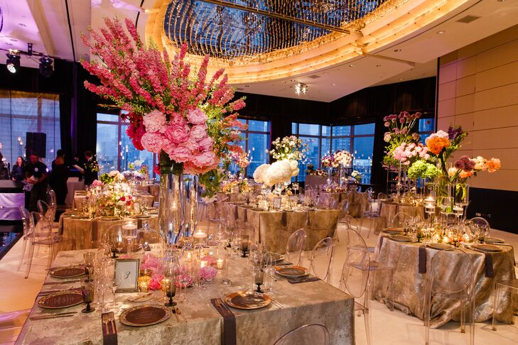 With the help of designer David Beahm, Allison and Jason transformed the ballroom at the Mandarin Oriental into a whimsical interpretation of a Parisian flower shop. Ghost chairs and floating candles provided an element of contemporary romance and glamour, while vibrant, architectural floral arrangements added drama and texture to the chic space.