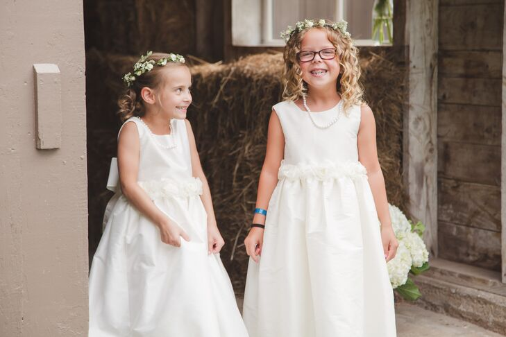 c67c87269 White Flower Girl Dresses and Floral Crowns at Farm Wedding